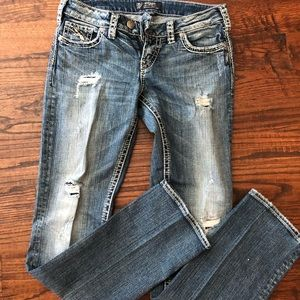 Silver distressed boot cut jeans